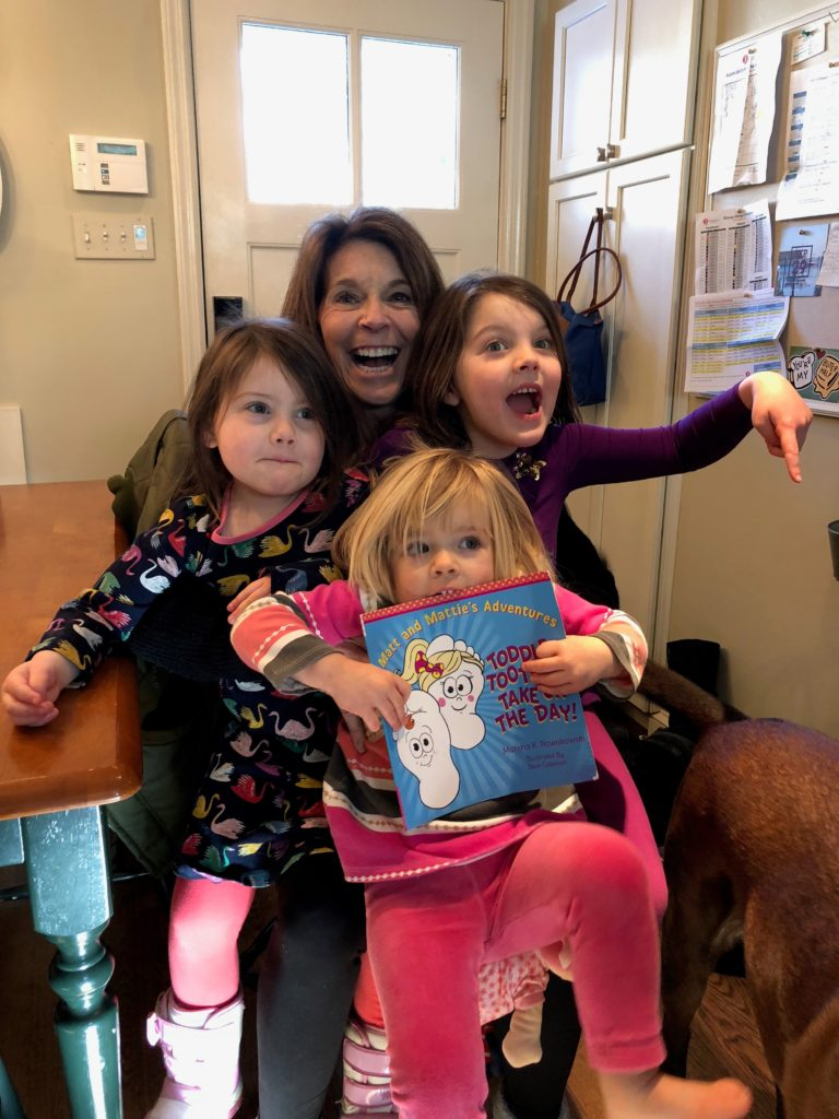 kids and mom and book